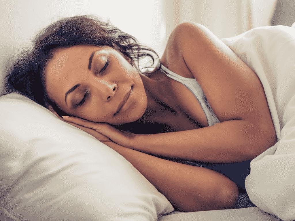 A woman makes her memory foam mattress cooler