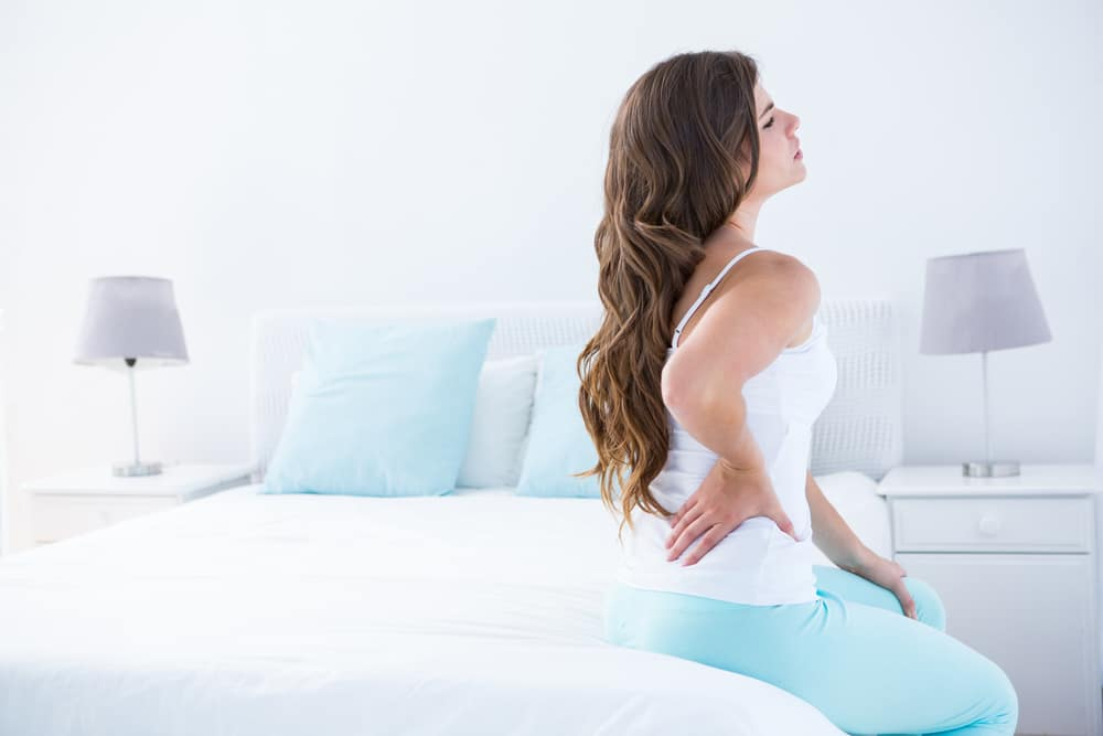 A woman suffers with lower back pain