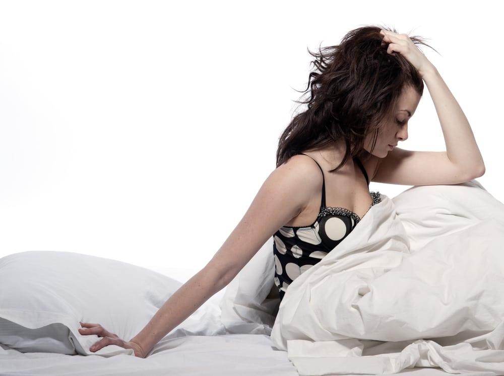 A woman on her memory foam mattress sweating