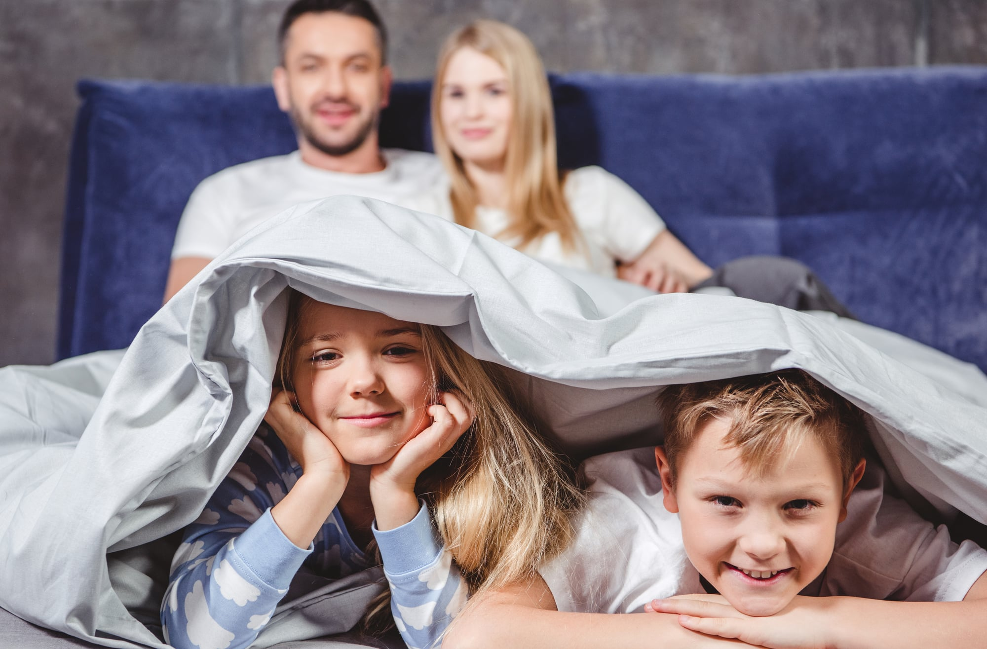 A family under their duvet in the UK